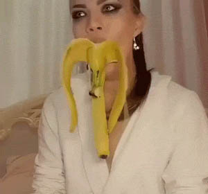 Beautiful girl and big banana animated GIF