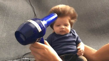 Funny baby hairstyle moving picture