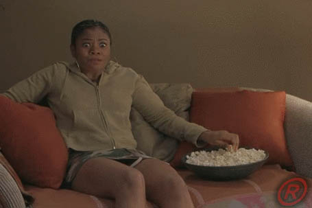 Girl watching horror movie animated GIF