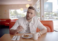 Justin Timberlake eats and moves animated GIF