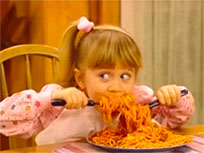 Little girl eating spaghetti animated GIF