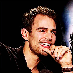 Theo James laughing animated GIF