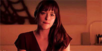 Anastasia Steele bites lip animated GIF