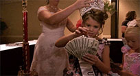 Little girl counts money free GIF download