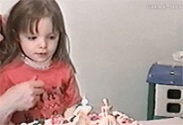 Kid blows out candles moving picture